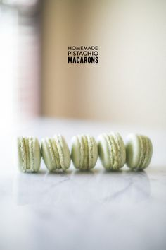One of the showstoppers from Sinclair & Moore's Easter Brunch that we featured was the perfect macarons that helped grace the table's centerpiece. Because when placed on a pretty white cake stand, wel. Pistachio Macaron Recipe, Macaroon Recipes, Pistachio Recipes, Just Desserts, Delicious Desserts, Dessert Recipes, Meringue Desserts, Coconut Desserts, Yummy Food