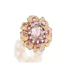 MORGANITE, DIAMOND AND GEM-SET RING Of floral motif design, centring on a cushion-shaped morganite weighing approximately 23.50 carats, surrounded by circular-cut diamonds and pink sapphires, to petals set with oval pink spinels and circular-cut diamonds, the pink spinels and diamonds together weighing approximately 4.05 and 3.30 carats respectively, mounted in 18 karat yellow gold.