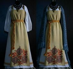 I thought this had a free hanging panel on front since the trim at the bottom stops at the center front panel but it appears to actually be completely sewn. Having the sides be a different color gives a very different look to the apron dress. The embroidery a reconstruction of the Oseberg ship embroidery fragment. By Savelyeva Ekaterina https://www.facebook.com/savelyeva.ekaterina.7?fref=photo