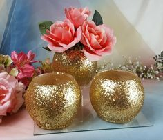 Custom Vase or Votive Candle Holders – 3 Vase or votive candle holders - They have a generous coat of glitter so that they shimmer.  Tea light included!  Description : I am sitting here looking at them as I write this. As a vase - I love it. It is made for a smaller bunch of flowers. As a Votive Holder, I am looking at one lit up. The glitter is on the outside and it sparkles. I love it. The glitter is everywhere on the outside,. Size - Tall 4.25 Tall Opening 3.25 Circumference - apx. 15…