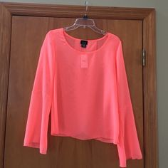 RUE 21 sexy blouse- NWT Beautiful lightweight blouse with flowy sleeves. Opens up in back (2nd photo). Gorgeous Coral color. Brand new. Rue 21 Tops Blouses