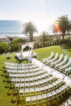 All-White Beach Ceremony | Photo: Brian Leahy Photography. View More:  http://www.insideweddings.com/weddings/beachy-southern-california-ceremony-winter-wonderland-reception/877/