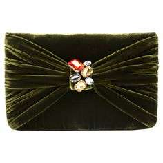 Velvet clutch in olive with a jeweled embellishment.  Product: ClutchConstruction Material: VelvetCo...