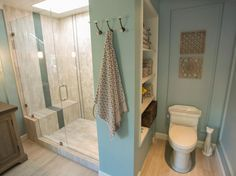Hall bathroom - open closet with built in wood shelves, no door to closet. Reuse current door.