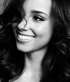 Perfect teeth, perfect color,  Beautiful voice and plays piano. .... Perfect woman.
