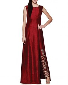 Crimson red sleeveless kurta with waist high slit and round neckline. This set also includes matching crimson red trousers with golden embroidery and sequins work. Wash Care: Dry clean onlyClosure: Zip at side