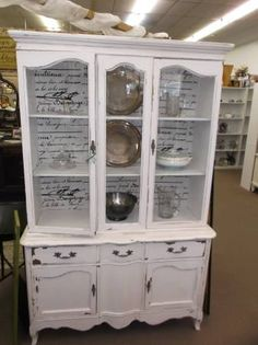 $335 - Charming vintage china cabinet is painted creamy white, distressed, and antiqued. With fabric inlay in double glass door cabinet & plate grooves on the shelves - 1 long drawer & 2 cabinets below for hidden storage! ***** In Booth D2 at Main Street Antique Mall 7260 E Main St (east of Power RD on MAIN STREET) Mesa Az 85207 **** Open 7 days a week 10:00AM-5:30PM **** Call for more information 480 924 1122 **** We Accept cash, debit, VISA, MasterCard or Discover.