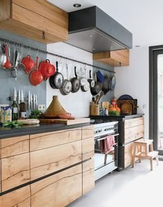 "Saw cut ""Splits"" in the Maple Cabinet fronts add the stand out finishing touch to this contempo Kitchen.....hanging Pans add a touch of Vintage Country."