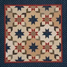 Red and blue stars team up in a patriotic wall quilt that incorporates red, navy, cream, and olive green reproduction prints.