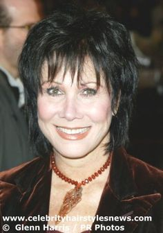 Michele Lee with a classic shag haircut emphasizing her high cheekbones