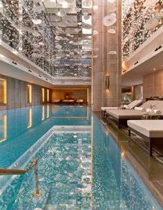 How to Create a Luxury Hotel Pool Look in the Home Creative Director of HBA London, Constantina Tsoutsikou, shares with The LuxPad her top luxury pool design tips which can be replicated in the home. Hotel Swimming Pool, Luxury Swimming Pools, Luxury Pools, Hotel Pool, Indoor Swimming Pools, Swimming Pool Designs, Dream Pools, Hotel Lounge, Luxury Resorts