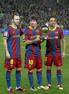 Messi Iniesta and Xavi