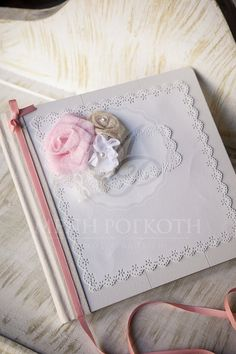 Beautiful handmade guest book with flower bouquet