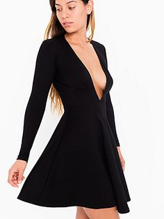 Ponte skater mini dress featuring plunging V-neck and long sleeves.