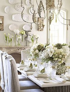 This table setting looks so soft and romantic....(ALSO... I love the white vintage plates on the wall)