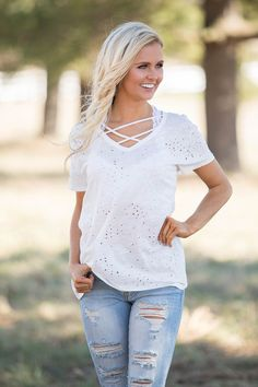 This gorgeous twist on a classic v-neck blouse is sure to add a stylish look to your spring wardrobe! Featuring a lightweight and soft material in a sweet white color, it's so breezy and easy to wear