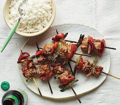 Glazed Pork Kebabs and Sesame Rice | Who can resist food served on a skewer? These deliciously simple recipes for meat, chicken, and seafood are fast to prepare and fun to eat.