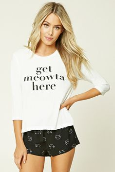 """A PJ set featuring a knit tee with a """"Get Meowta Here"""" graphic, round neckline, and 3/4 sleeves, as well as a pair of woven shorts featuring a cat print, bow front, and an elasticized waist."""