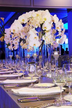modern orchid centerpiece..love the blue lights