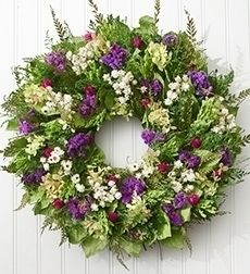 """Garden Jewel Wreath $79.99 The quiet majesty of the Garden Jewel Wreath gathers spring and summer blooms like ammobium, fern, hydrangea and more, for an artful gift to set her into her gardening zone. Colorful, hand-crafted wreath features ammobium, fern, sinuata, natural hydrangea, natural leaves and green sorghum Long-lasting gift can be displayed indoors or outdoors on a protected front door Measures 18""""H x 18""""W x 5""""L To help preserve its beauty, the wreath can be sprayed lightly with…"""