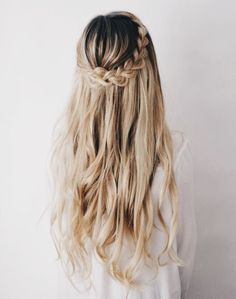 Beautiful braided hairstyle. Try a softening cream like Rahua Finishing Treatment to smooth and hydrate ends and tame flyaways