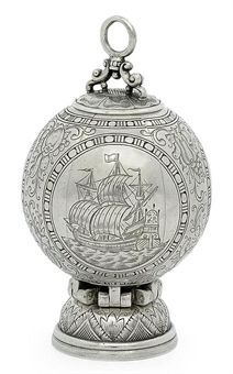 A LARGE DUTCH OR GERMAN SILVER POMANDER --  APPARENTLY UNMARKED, LAST HALF 17TH CENTURY  Globular, the sides engraved with two portrait busts within medallions and with a further medallion engraved with a galleon at sail, all surrounded by fruiting foliage, with an overhead ring handle and a spreading foot, opens to reveal six compartments, the cover of each engraved with the name of a different scent, the base detaches to reveal an integral spoon