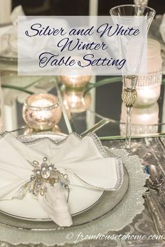Silver and White Winter Table Setting | Looking for some ideas on a white and silver winter table setting for Christmas, New Year's or a winter themed party? Click here to get some inspiration.