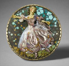 KEVIN COATES PENUMBRA 1: LA CAMARGO  Brooch in wall mount. Brooch: 20K & 18K gold, silver, turquoise matrix, cameo-carved (stratified) mother-of-pearl Mount: wood, acrylic, paint, photo-collage  Brooch: 61mm diameter Mount: 281mm high x 366mm long