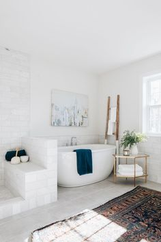 corner of bathroom with large stand-alone tub and decorative ladder. Neutral Bathrooms Designs, Country Wall Mirrors, Decorating Your Home, Diy Home Decor, Oak Floating Shelves, Stand Alone Tub, White Couches, Modern Style Homes, Farmhouse Kitchen Decor