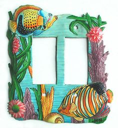 Decorative tropical fish design switchplates are handcrafted from steel drums and beautifully hand painted. Perfect addition to your tropical home decor. Created from recycled steel drums in Haiti. Tropical Artwork, Tropical Wall Decor, Tropical Design, Tropical Interior, Decorative Light Switch Covers, Switch Plate Covers, Light Switch Plates, Painted Metal, Hand Painted