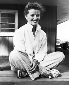 Katharine Hepburn gave her whites a refreshing menswear-inspired spin, selecting an oversize fit (with the collars popped) that she teamed with creased trousers.