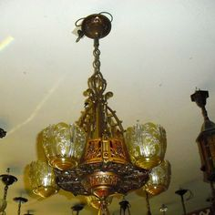 """This is a signed """"Lincoln"""" Art Deco chandelier that is circa 1920. The light hangs 36"""" from the ceiling when measuring to the bottom of the finial (adjustable length), and has a 19"""" diameter."""