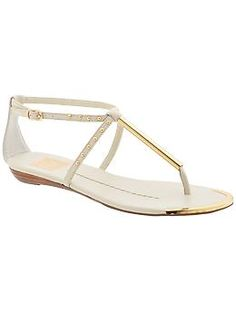 DV by Dolce Vita Apollo Sandal (Piperlime, $69.00) - bone white, t-strap, gold hardware accents, gold studs, gold border, flat with mini wedge, simplistic, modern.