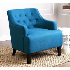 Add a vibrant pop of color to any space with the Abbyson Living Davis Petrol Blue Fabric Armchair. This chair features elegant tufted accents that add a classic style that you will be sure to love.