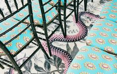 On Set: Held inside a former open-air train station, the Gucci Spring Summer 2016 fashion show was an intriguing affair. From the carpeted platform of pink snakes slithering across black flowers to the printed silk screens framing the runway, the set was provocative in its tenderness.