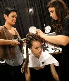 Backstage: TRES lead stylist, Jeanie Syfu, creates a curl set on a model for the Jenny Packham look #TRESmbfw #mbfw