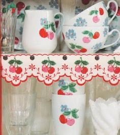 so vintage so cherry...  great idea trim the shelves in ribbon/trim to match the items on the shelves! I so need to do this!