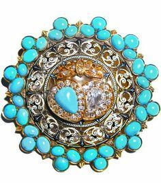 A Gold, Enamel and Gem-set Brooch by Carlo Giuliano, The turquoise is significant as its colour closely resembles of the Forget-Me-Not. The diamond, which is famed for being incorruptible and indestructible, is mblematic of eternal love (a sentiment which is reiterated by the shape of the brooch, which is an unbroken circle). The two hearts in the centre of the jewel have been tied together by the ribbon above, a motif which represents hearts united by true love., English, circa 1890, 4.5 cm