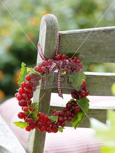 Small wreath of redcurrants on garden chair Christmas Wreaths, Christmas Crafts, Fruit Decorations, Rich Image, Mo S, Garden Chairs, Unique Photo, Small Wreath, Royalty Free Photos