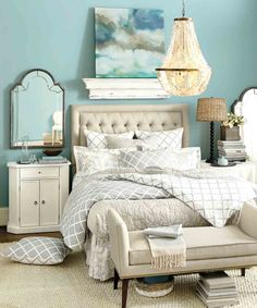 We love to let our artwork inspire our wall colors. The perfect shade of blue ties everything together in this pretty bedroom.
