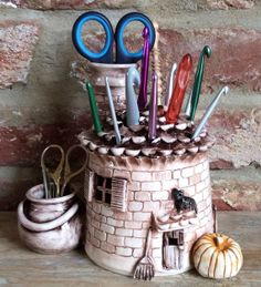 Witches Cottage Crochet Hook Holder :: So cool!  But way too expensive for me.