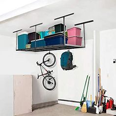 34 Creative Hacks To Organize Your Stuff For Garage Storage Ceiling Storage Rack, Garage Storage Racks, Overhead Garage Storage, Garage Organization, Bicycle Storage, Storage Spaces, Storage Ideas, Corner Storage, Living Room Designs