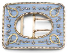 A FABERGÉ JEWELLED GOLD AND ENAMEL BELT BUCKLE, WORKMASTER HENRIK WIGSTRÖM, ST PETERSBURG, 1908-1917 of rounded rectangular form, the surface of gold-lined opaque cerulean enamel applied with gold laurel and rose-cut diamond-set ribbons and rosettes, seed pearl borders, struck with workmaster's initials and Fabergé in Cyrillic, 56 and 88 standards, scratched inventory number 23144