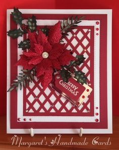 For this card I die cut the centre of the Sue Wilson Lattice die in red and also cut two frames from the die, one in red and one in white. I added a double sided adhesive sheet to the lattice and added white glitter to this. I die cut the poinsettia and foliage and the tag and finished with a few gems.
