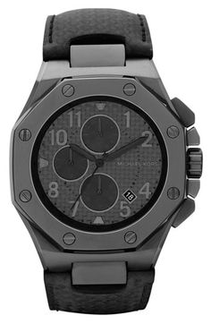 Michael Kors - Blacked out w/ canvas textured face.