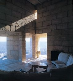 Jorn Utzon's own vacation house in Mallorca.  I love how the top light accentuates the materiality wo the wall.