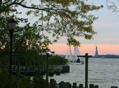 Take a walk through Battery Park City for views of the harbor, the Statue of Liberty, and Jersey City