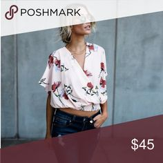"""IN STOCK! Blush Floral Blouse (Previously sold through Vici). Features a wrap front, elastic hem, & a tie on the back.                                       Size Small: 21"""" from shoulder to hem 100% Polyester Sadie & Sage Tops Blouses"""