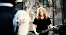 """Watch Megadeth's new video for """"Lying in State,"""" in which their mascot, Vic Rattlehead, goes on a sword-wielding rampage."""