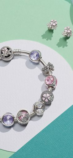 Mix your Radiant Droplet PANDORA charms with subtle pink hues for a picture perfect look.